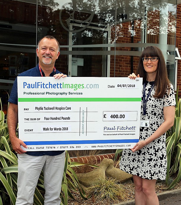 Charity donation by Paul Fitchett Images